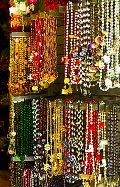 Mardi grass beads on display in a store in New Orleans