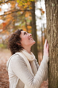 Woman looking at tree