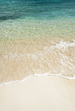 Beach and clear ocean water