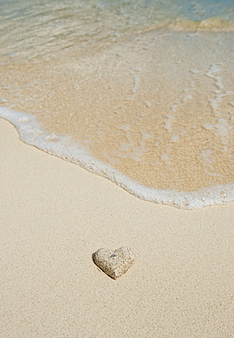 Heart shaped sand on beach