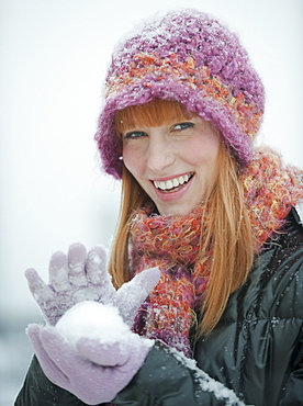 Woman packing snowball