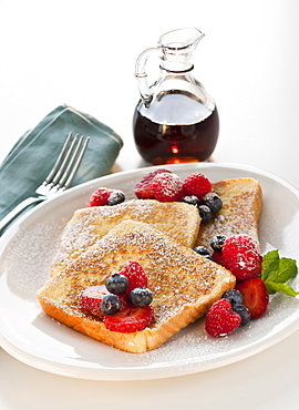 Studio shot of French toast with fruits and syrup