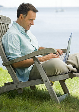 Man working on laptop outdoors
