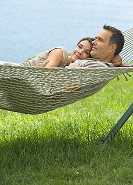 Couple laying in hammock