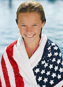 Girl wrapped in American flag towel
