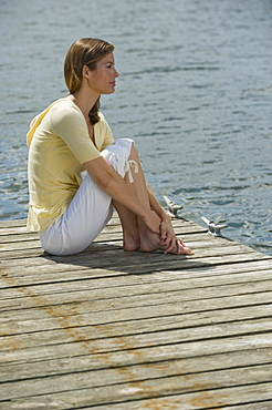 Woman sitting on dock