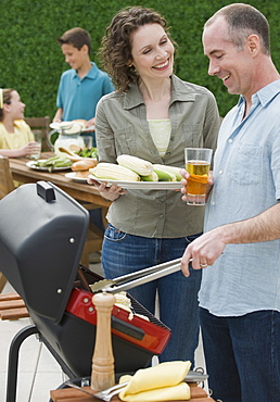 Family with two children barbecuing