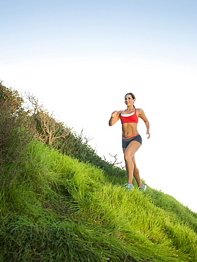 Woman training on hill