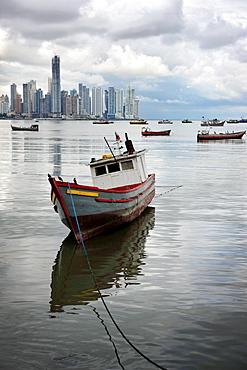 Panama, Panama City, Fishing boat with skyline in background