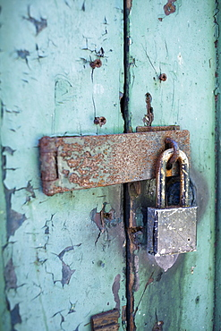 Old rusty padlock on door