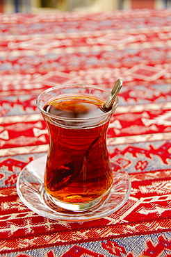 Turkey, Istanbul, glass of tea on table
