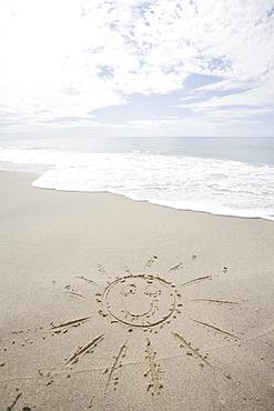USA, Massachusetts, Sun drawn on sandy beach