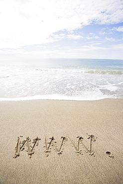 USA, Massachusetts, WWW drawn on sandy beach