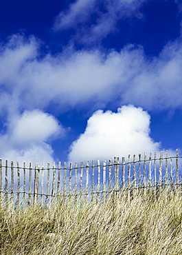 France, Picket fence, grasses and blue sky