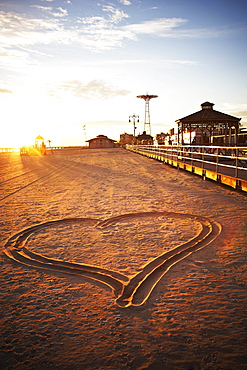 USA, New York City, Coney Island, heart shape in sand