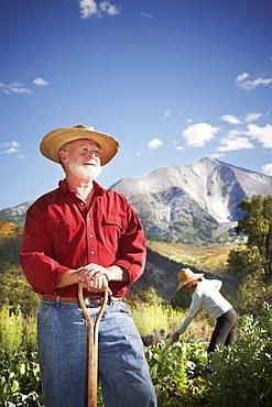 USA, Colorado, Aspen, portrait of male farmer working in field