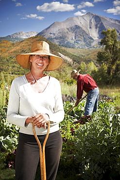 USA, Colorado, Aspen, portrait of female farmer working in field