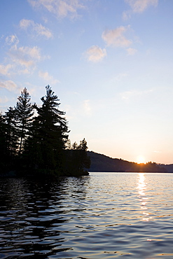 USA, New York State, Adirondack Mountains, Upper Saranac Lake at sunset