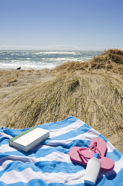USA, Massachusetts, towel on Marram Grass on beach