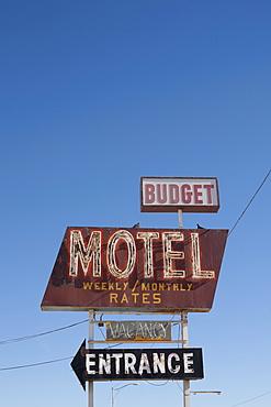 USA, Arizona, Winslow, Old-fashioned motel sign against blue sky