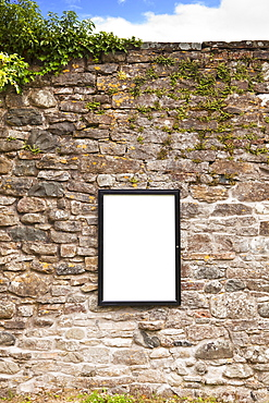 Blank sign on stone wall