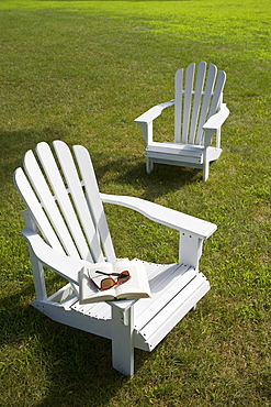 Two adirondack chairs on lawn
