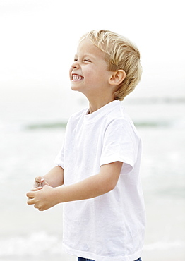 Portrait of boy (4-5) playing on beach