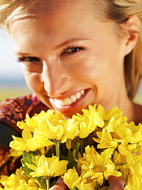 Woman holding yellow flowers