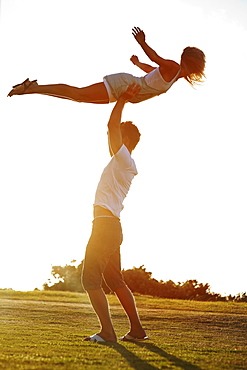 Man lifting girlfriend