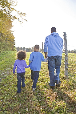 Father and children walking
