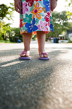 Young girl wearing flip flops
