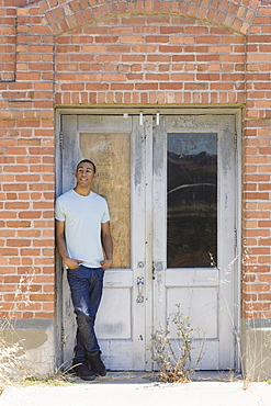 Young man at abandoned building