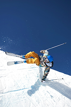 A downhill skier doing a trick