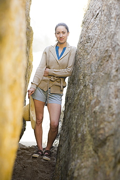 A woman standing between two rock walls