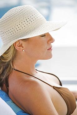Woman relaxing poolside