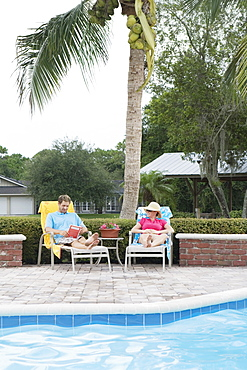 Couple relaxing poolside