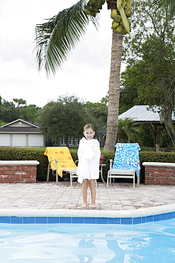 Girl standing at edge of swimming pool