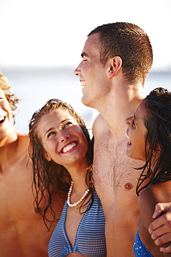 Young couples laughing on beach