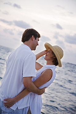 Couple hugging in front of water
