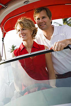 Couple driving boat