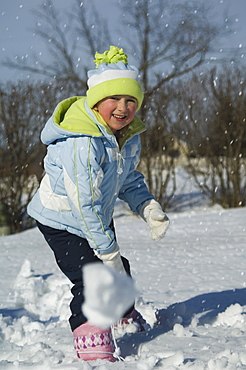 Girl throwing snowball
