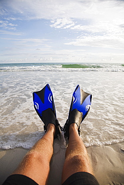 Man wearing flippers at beach, Florida, United States