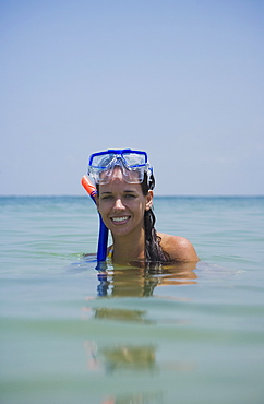 Woman wearing snorkeling gear in water, Florida, United States