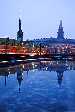 View over canal towards Copenhagen Stock Exchange and Christiansborg Castle