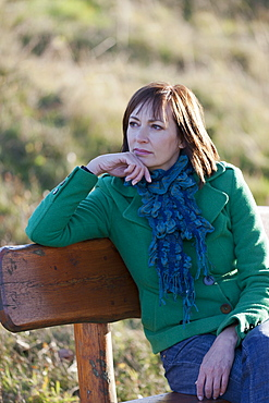 Portrait of mature woman on bench