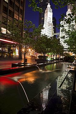 USA, Illinois, Chicago, Fountain and Wrigley Building illuminated at night