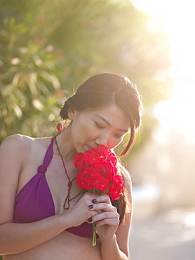Mid adult woman smelling bouquet