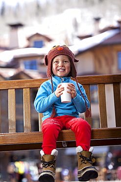 USA, Colorado, Telluride, Boy (4-5) enjoying hot chocolate