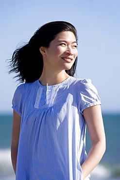 USA, California, Point Reyes, Pensive young woman at coast