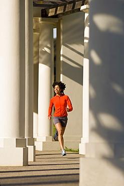USA, California, Oakland, Young woman jogging